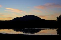 Mountain and Lake at Sunset stock photo