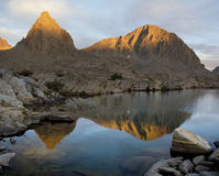 Mountain lake at sunset. View of the mountain accross a quiet lake after a long hike Stock Photography