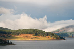 Mountain lake at sunset with clouds Royalty Free Stock Photo