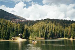 Mountain lake surrounded by forest, harmony of nature. Synevyr lake in Carpathians, Ukraine Royalty Free Stock Photo