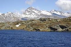 Mountain lake, swiss alps Stock Photos
