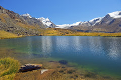 Mountain lake in the Swiss Alps Royalty Free Stock Image