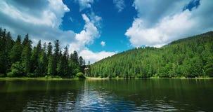 Mountain lake timelapse stock video