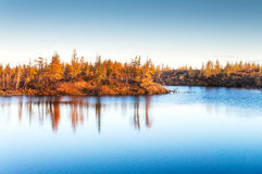 Mountain lake in tundra, deep autumn in the Taimyr Peninsula near Norilsk. Royalty Free Stock Photos
