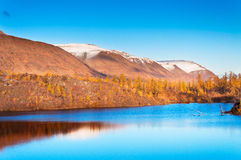 Mountain lake in tundra, deep autumn in the Taimyr Peninsula near Norilsk. Stock Photos