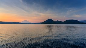 Mountain and Lake at Twilight in Hokkaido, Japan Stock Photos