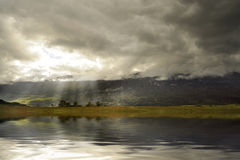 Mountain lake under the clouds Royalty Free Stock Photos