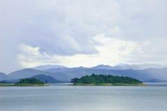 Mountain lake under cloudy sky.  Stock Photos