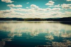 Mountain Lake Under a Deep Blue Sky. A Mountain Lake Under a Deep Blue Sky Stock Photo