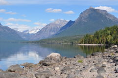 Mountain Lake View in Glacier National Park. A scenic mountain lake view of snow capped peaks in Glacier National Park Royalty Free Stock Images