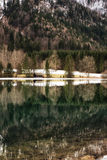 Mountain lake Vorderer Langbathsee in Salzkammergut, Upper Austr. Forest Reflection and Lake House at the  Langbathsee in Austria Royalty Free Stock Photos