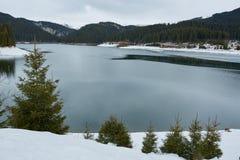 Mountain lake on wintertime Stock Photos