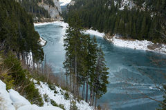 Mountain lake on wintertime Stock Images