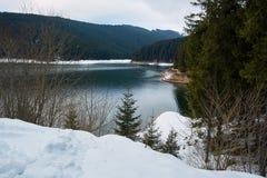 Mountain lake on wintertime Stock Photo