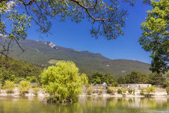 Mountain lake in the woods. And blue sky Stock Photo
