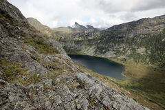 Mountain lake `Zolotarnoe` in the natural Park Ergaki. At the foot of the ridges of the Western Sayan mountains in the valley is a lake with clean fresh water Stock Image