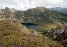 Mountain lake `Zolotarnoe` in the natural Park Ergaki. At the foot of the ridges of the Western Sayan mountains in the valley is a lake with clean fresh water Royalty Free Stock Photography
