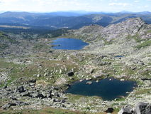 Mountain lakes. Stone blocks pass western Sayan Syberia hills clean clear water Royalty Free Stock Images