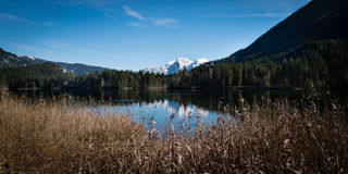 Mountain  and lakeview at Hintersee in Bavarias Berchdesgaden. The idyllic Hintersee in Bavarias Berchdesgaden Nationalpark with view of the mountains of the Stock Photography
