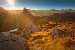 Mountain landsape towards the rising sun Stock Photography