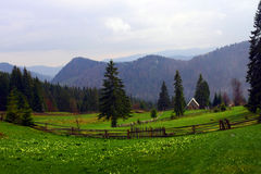 Mountain landscape. With wooden fence and little house Royalty Free Stock Photo