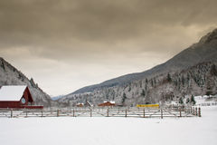 Mountain landscape. With a cabin and fence in winter Royalty Free Stock Image