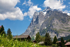 Mountain landscape. With green grass, houses, beautiful sky stock image