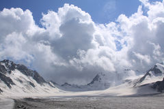 Mountain landscape. Cumulus clouds above the glacier Royalty Free Stock Photography