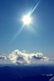 Mountain landscape. Mountain view with sun and clouds in winter time Royalty Free Stock Images