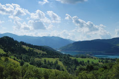 Mountain landscape. With green fields and lake behind Royalty Free Stock Photography