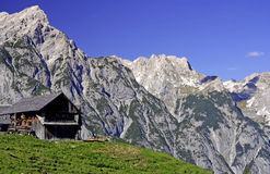 Mountain Landscape. Scenic landscape of Karwendel mountain range in Austria with wooden hut and meadow Royalty Free Stock Images