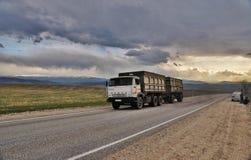 Mountain landscape automobile deviled Kamaz Stock Photos