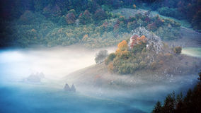 Mountain landscape with autumn morning fog at sunrise - Fundatur Royalty Free Stock Images