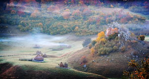 Mountain landscape with autumn morning fog at sunrise Royalty Free Stock Image