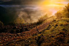 Mountain landscape with autumn morning fog at sunrise Royalty Free Stock Photo