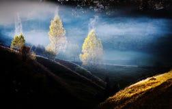 Mountain landscape with autumn morning fog at sunrise Stock Images