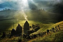 Mountain landscape with autumn morning fog at sunrise - Romania royalty free stock photography