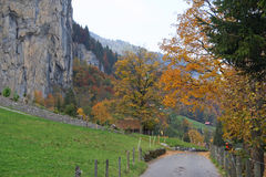 Mountain landscape in autumn with walking path in autum in Switzerland. View at mountain landscape with walking path in  autumn in Lauterbrunnen Switzerland Stock Images