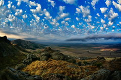 Mountain landscape with beautiful sky in Dobrogea, Romania. Mountain landscape with beautiful cloudy sky in Dobrogea, Romania Royalty Free Stock Photos