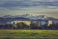Mountain landscape with block of flats Stock Photos