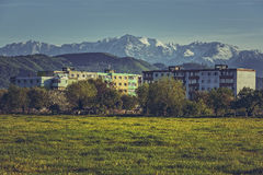 Mountain landscape with block of flats Royalty Free Stock Image