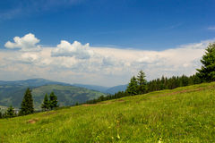Mountain landscape with blue cloudy sky Stock Image