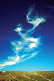 Mountain landscape with blue sky. Mountain landscape with dragon cloud over the sky Royalty Free Stock Image
