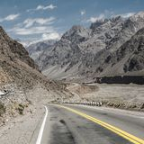 Mountain landscape with blue sky and empty road royalty free stock images