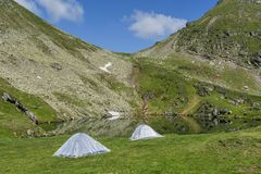 Mountain landscape with camping tents near the lake. Stock Image