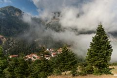 Mountain landscape central Greece, Karpenisi region. Mountain landscape. View of the mountains, the village of Fidakya, pine forest in the morning, foggy day royalty free stock photography
