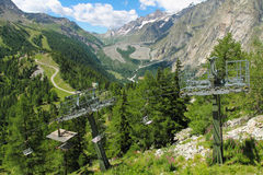 Mountain landscape and chair lift Stock Photo