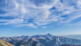 Mountain landscape - cirrus clouds. Mountain landscape, sunny day - cirrus clouds timelapse stock video