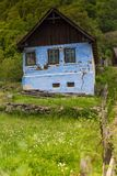 Mountain landscape cottage. Old barn scene in the mountains of Transylvania Royalty Free Stock Photography