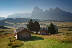Mountain landscape with cottages. Alpe di Siusi. Dolomites. Italy royalty free stock photography